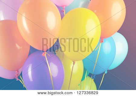 Colorful balloons on dark background, clothe-up. Retro style