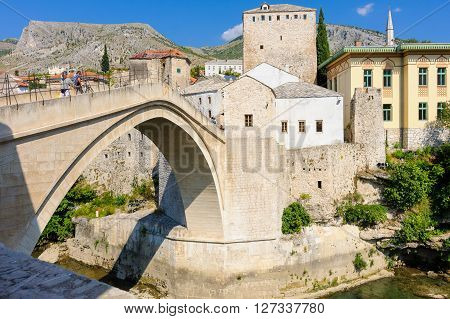 MOSTAR BOSNIA AND HERZEGOVINA - SEPTEMBER 1 2009: The new Stari Most (old bridge) reconstructed from local tenelia stone.