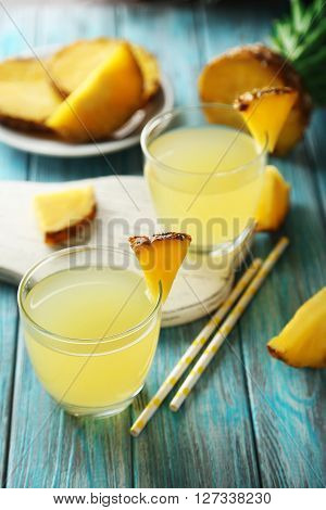 Glasses Of Pineapple Juice On A Blue Wooden Table