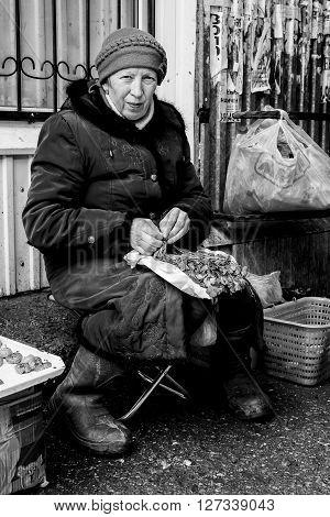 Russian Market Seller Preparing Herbs