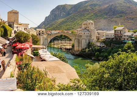 MOSTAR BOSNIA AND HERZEGOVINA - SEPTEMBER 1 2009: The new Stari Most (Old Bridge) Tara Hercegusa and Halebija towers