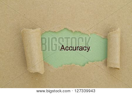 Accuracy word written under torn paper concept.