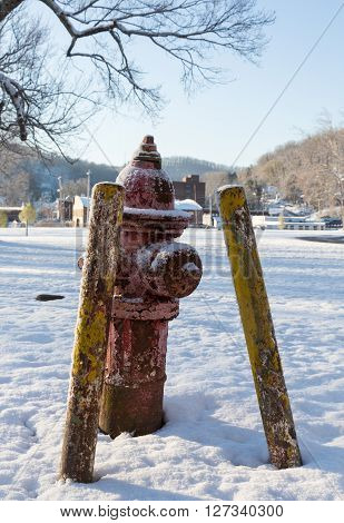 Old Red Fire Hydrant In Snow In Winter