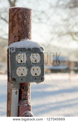 Close Up Of Electric Sockets Outdoors In Snow