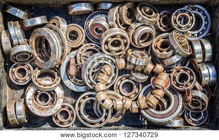Pile Of Old Rusty Ball Bearing Wheels