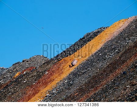 Massive colorful dump of depleted iron ore