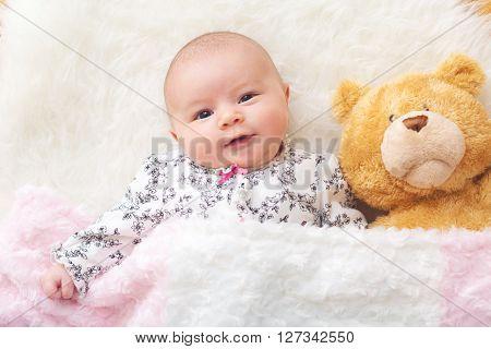 Newborn Baby Girl On Her Blanket With Her Teddy Bear