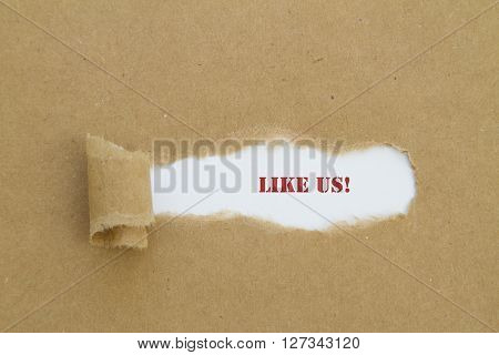 Like us word written under brown torn paper.
