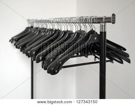 stand with clothes hangers