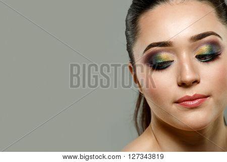 Close up portrait of beautiful young woman face. Makeup concept.