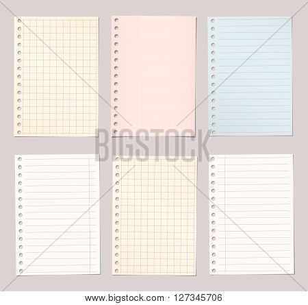 Light colorful lined and squared notebook paper are stuck on brown background.