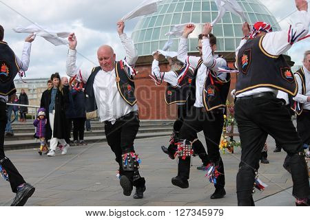 GREENWICH LONDON UK - MARCH 13TH: Blackheath Morris men dancers demonstrate old English folk dancing to the public on Easter Sunday March 13th 2016 in Greenwich London by the Cutty Sark Boat