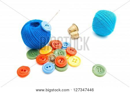 Buttons, Thimbles And Thread On White