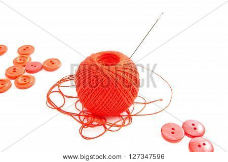 Thread, Needle And Red Buttons