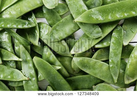 Vegetable. Green peas on the table