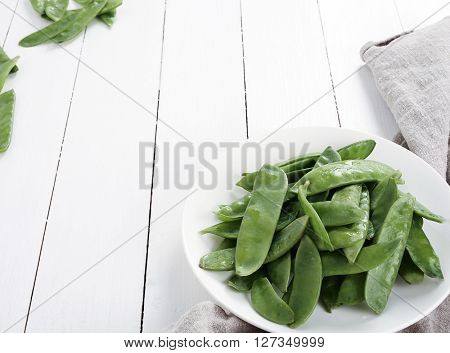 Vegetable. Green peas on a dish