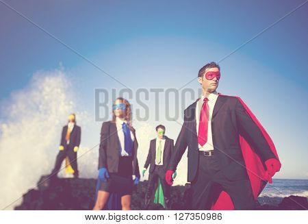 Business superheroes on the beach.