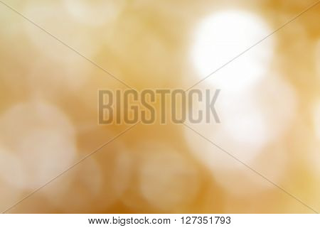 Bokeh light spots on brown blurred background