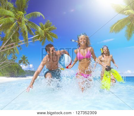 People playing at a tropical beach.
