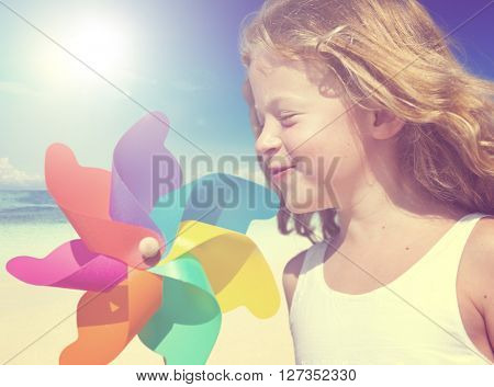 Little Girl Smiling Playing Beach Summer WIndy Concept