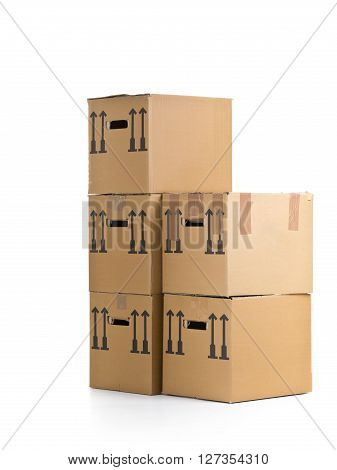 Stacked moving carton boxes over white background