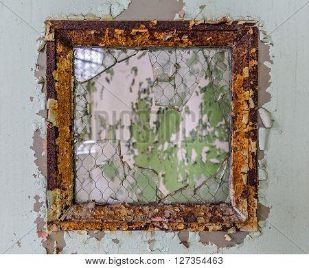 Broken Glass In Window Onto Empty Room