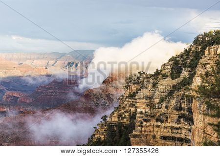 Misty and Foggy Grand Canyon scene during sunset in South Rim, Arizona