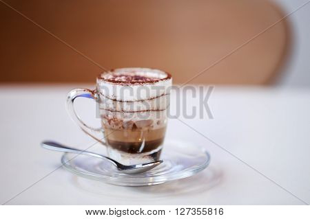Italian traditional coffee macciato, made in Milan. This beverage contains dark chocolate, hot frothed milk and espresso.