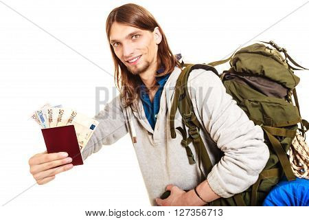 Man tourist backpacker holding passport full of money. Young guy hiker backpacking. Summer vacation travel. Studio shot. Isolated on white background.