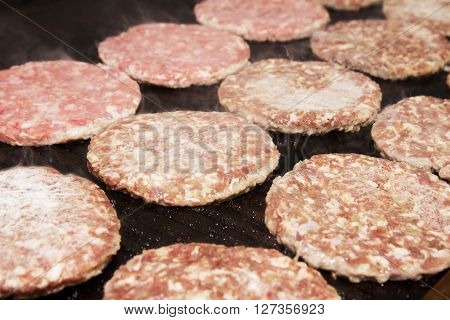 Raw Ground beef meat Burger barbecue in process