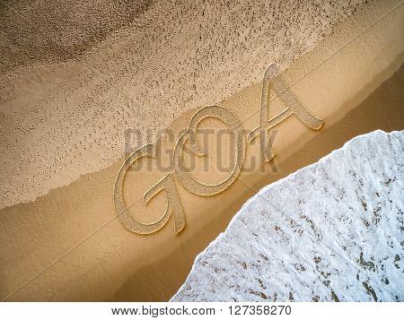 Goa written on the beach