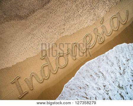 Indonesia written on the beach