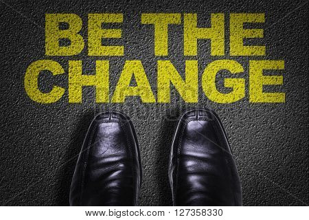 Top View of Business Shoes on the floor with the text: Be The Change