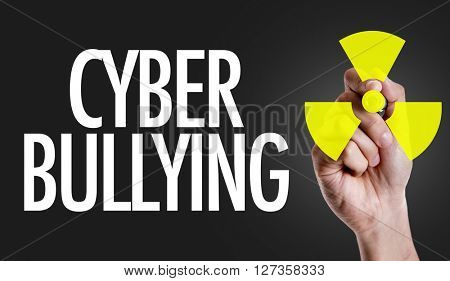 Hand writing the text: Cyber Bullying