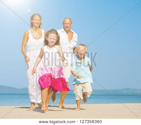 Family Running Beach Playful Lifestyle Concept