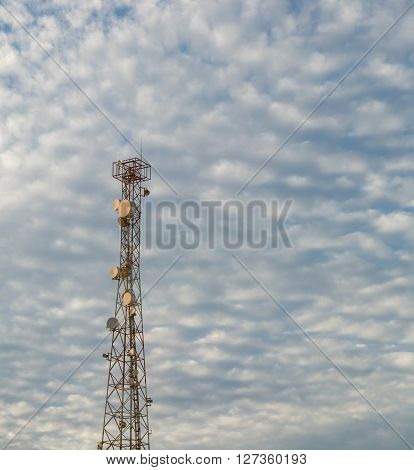 Antenna tower and blue sky with white cloud