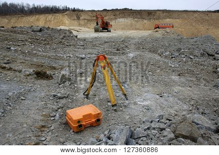a tripod and a box of surveyor on construction site