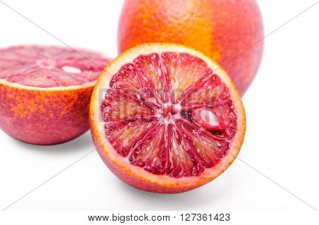 Red oranges cut in half isolated on white background