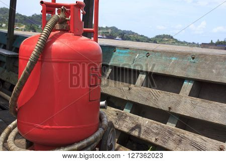 huge fire extinguisher was expired on the wooden tug
