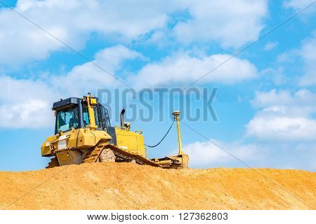 Large view on the bulldozer working on the construction site