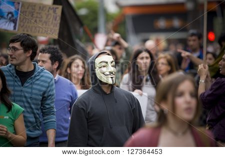 Badajoz Spain - March 29 2012: anonymous protester at against austerity cuts demostration March against the Labor Reform approved by the Government of Spain on March 2012
