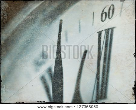 Grunge effect applied to clock face with minute hand approaching the twelve position.
