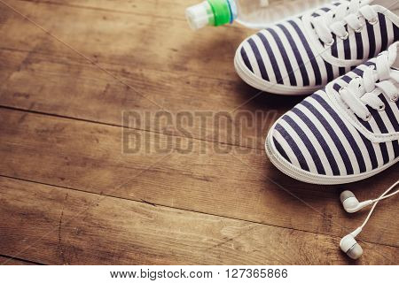 Shoes, water bottle and earphones. Healthy lifestyle background with blank copy space