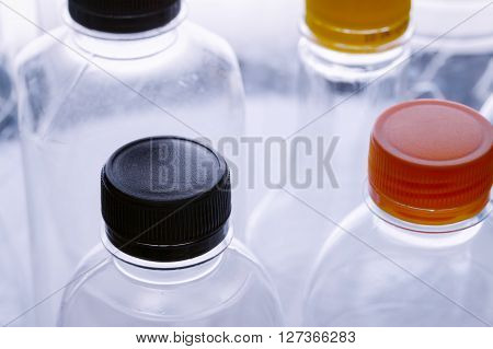 Close Up Plastic Cap And Bottle Background For Recycle Concept