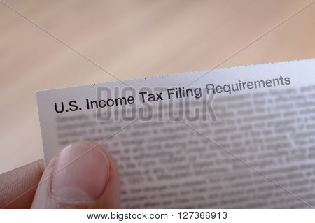 Us Incoming Tax And Hand For Business Concept Background