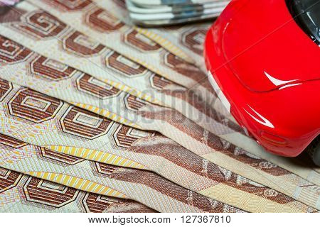 Thai Baht Banknotes And Car Mockup Closeup On Table Background