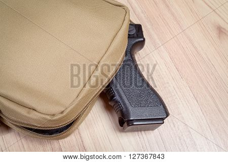 Weapon Gun In Bag, Khaki Or Sand Color, On Table Background