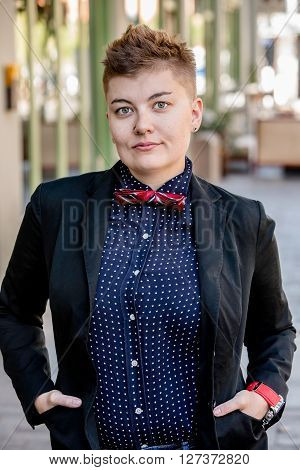 Serious Dapper Gender Fluid Young Woman
