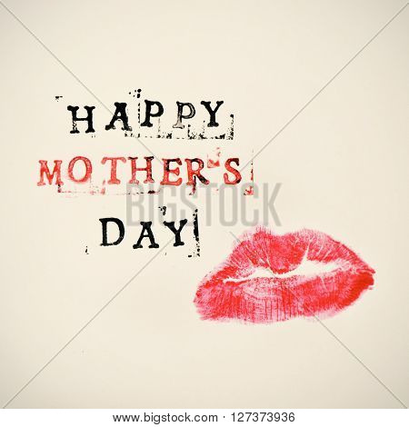 the print of a kiss and the text happy mothers day printed in black and red in a beige gradient background