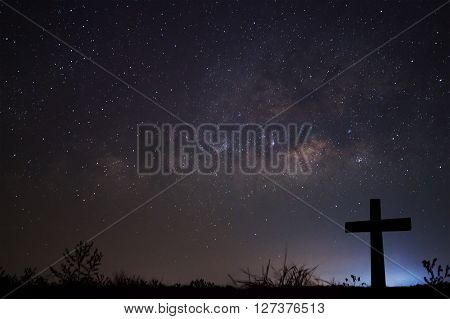 Silhouette Of Cross Over Milky Way Background,long Exposure Photograph.